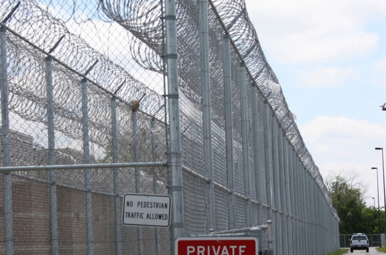 AmeriFence Corporation Wichita - High Security Fencing, 2103 Correctional fence with Concertina wire
