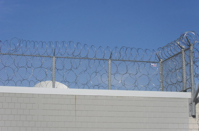 AmeriFence Corporation Wichita - High Security Fencing, Four Stack Concertina Wire