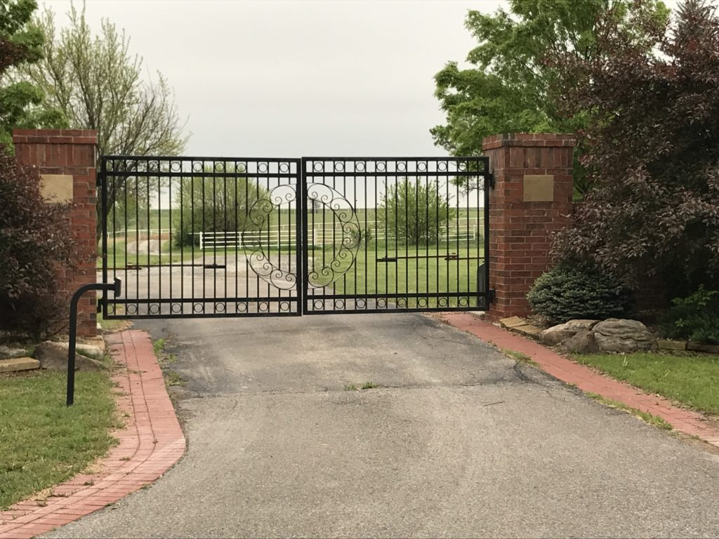 Automatic ornamental swing gate installed in a driveway leading to a Wichita, Kansas residence