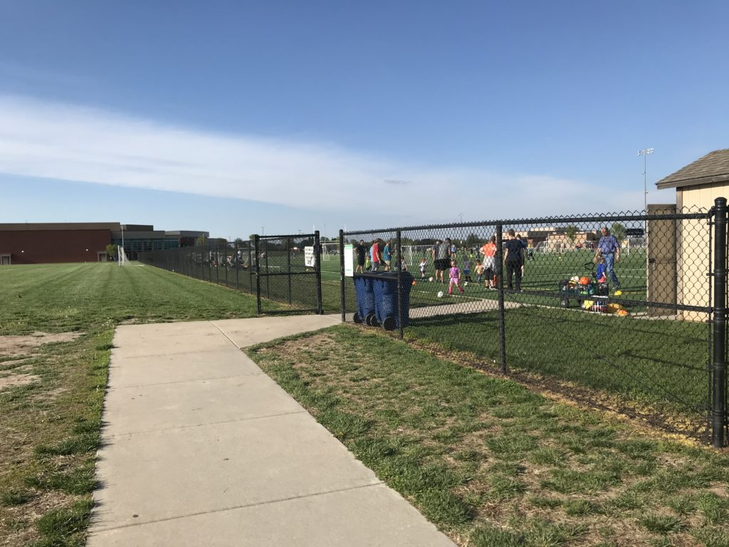 YMCA black chain link fence with top rail and middle rail