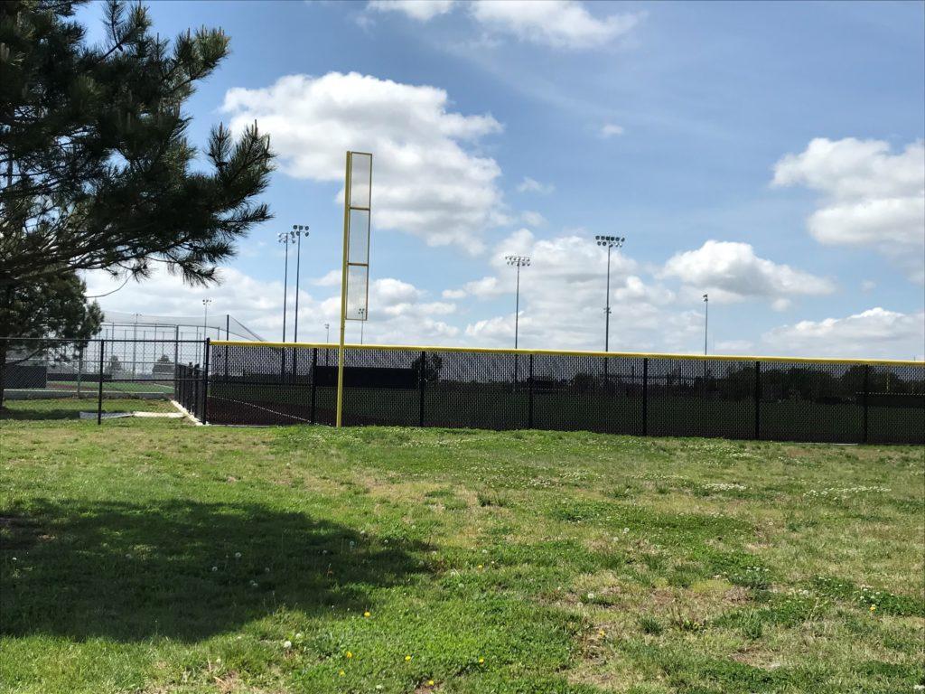 Maize South High School baseball field fencing in Wichita with windscreen
