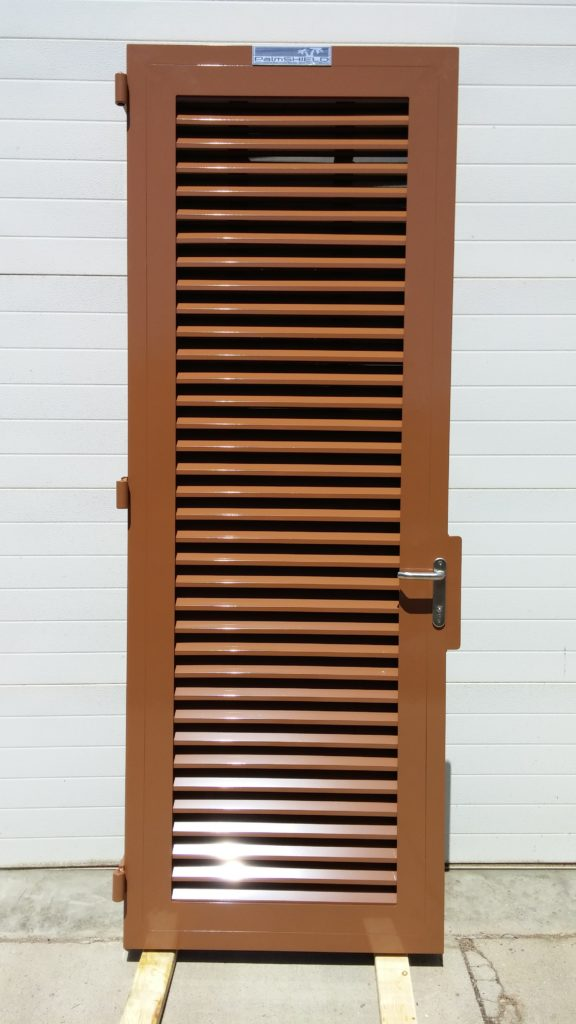 Louvered industrial gate with brown powder coating